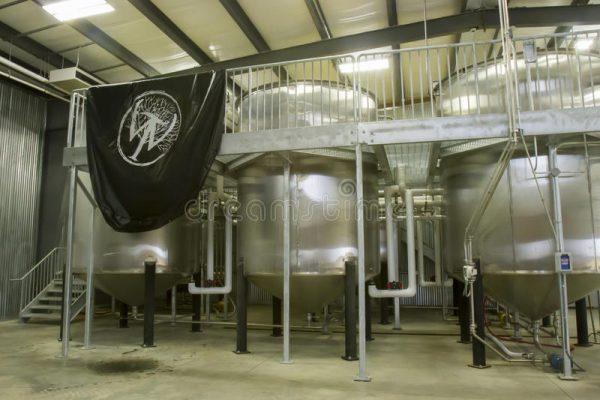 wilderness-trails-distillery-fermentation-vats-danville-ky-usa-october-banner-metal-inside-bourbon-factory-80989410